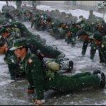 Солдаты НОАК отжимаются на обледенелом строевом плацу